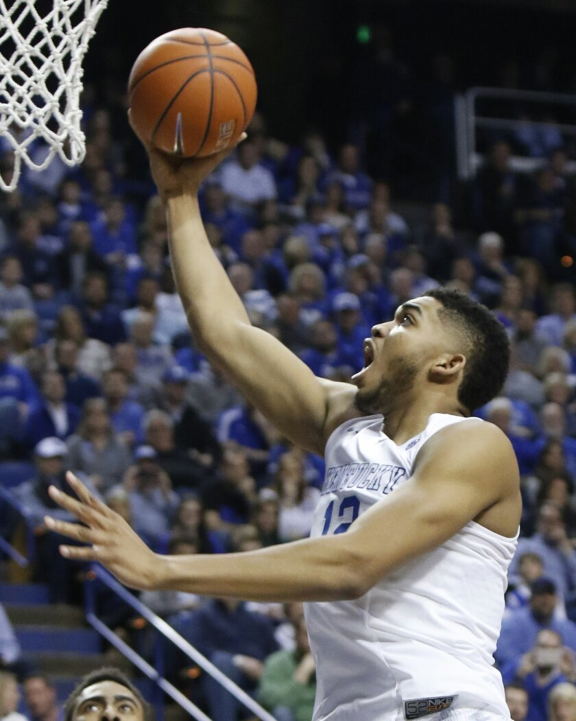 Kentucky's Karl-Anthony Towns shoots during the first half of an NCAA college basketball game against Auburn, Saturday, Feb. 21, 2015, in Lexington, Ky. (AP Photo/James Crisp)