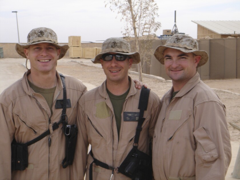In happier times, Maj. Scott Weinpel, Capt. Kevin Kryst and Maj. Tali Burton, l to r; Kryst was killed in Iraq in 2006.