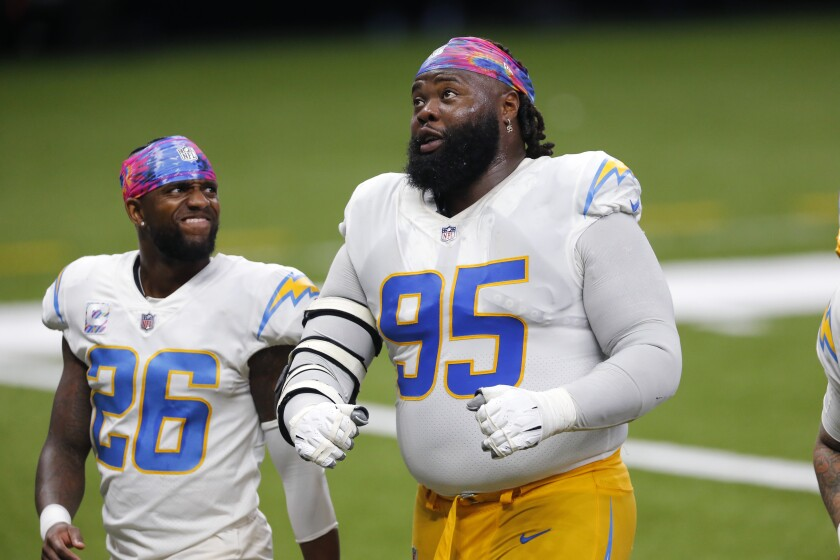 Chargers defensive tackle Linval Joseph (95) and cornerback Casey Hayward walk off the field.