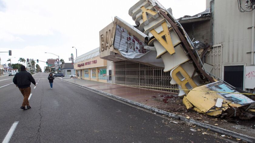 A sign at the former Bay Theatre on National City Boulevard toppled during the height of a wind and rain storm that hit the region earlier this month.