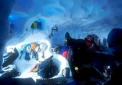 Mark Newcomb reads amid the tangle of fellow climbers huddled inside a Paso Superior Glacier snow cave.