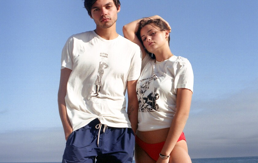 Two models wearing T-shirts