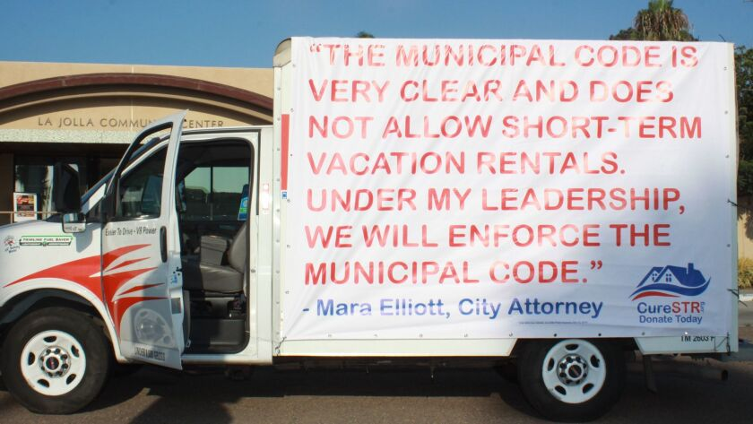 A truck in front of La Jolla Community Center greeted attendees of an Aug. 30 town hall meeting with