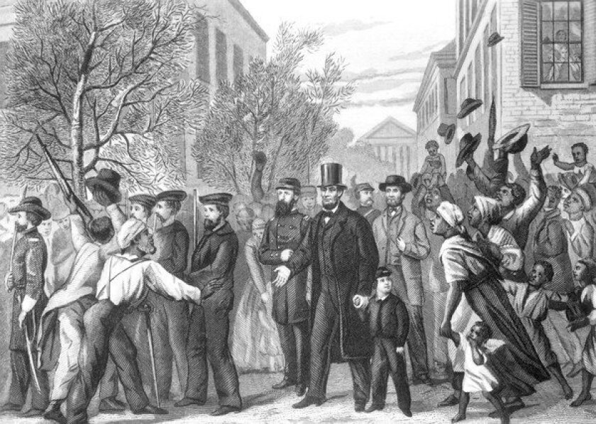 Abraham Lincoln in Richmond, Va., on April 3, 1865, shortly after it was captured by Union troops who freed the slaves that are crowding around the president. Engraving by J.C. Butt after a drawing by L. Hollis.