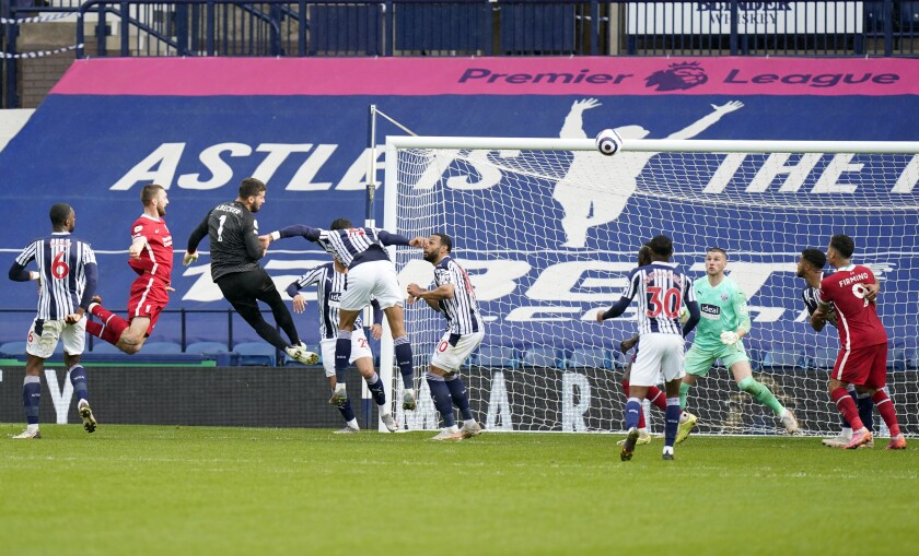 Liverpool's goalkeeper Alisson, third left, scores his side's second goal during the English Premier League soccer match between West Bromwich Albion and Liverpool at the Hawthorns stadium in West Bromwich, England, Sunday, May 16, 2021. (Tim Keeton/Pool via AP)