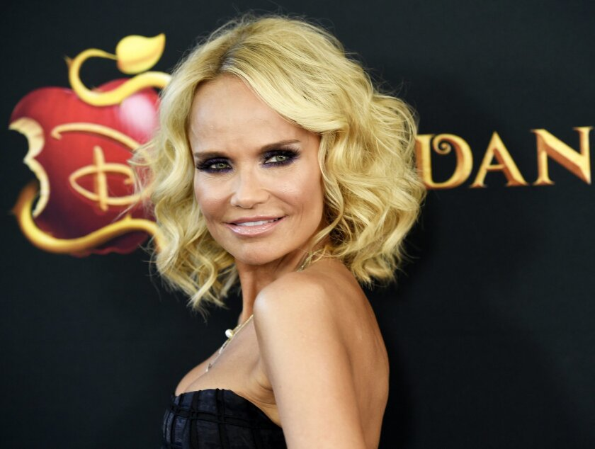 "FILE - In this July 24, 2015 file photo, Kristin Chenoweth, a cast member in ""Descendants,"" poses at the premiere of the film in Burbank, Calif. Broadway heroines are rolling up their sleeves and posing in a familiar way to support National Women's Equality Day. Chenoweth, Laura Benanti and Patina Miller were some of the women on Twitter or Instagram striking the classic Rosie the Riveter pose Wednesday, Aug. 26. (Photo by Chris Pizzello/Invision/AP, File)"