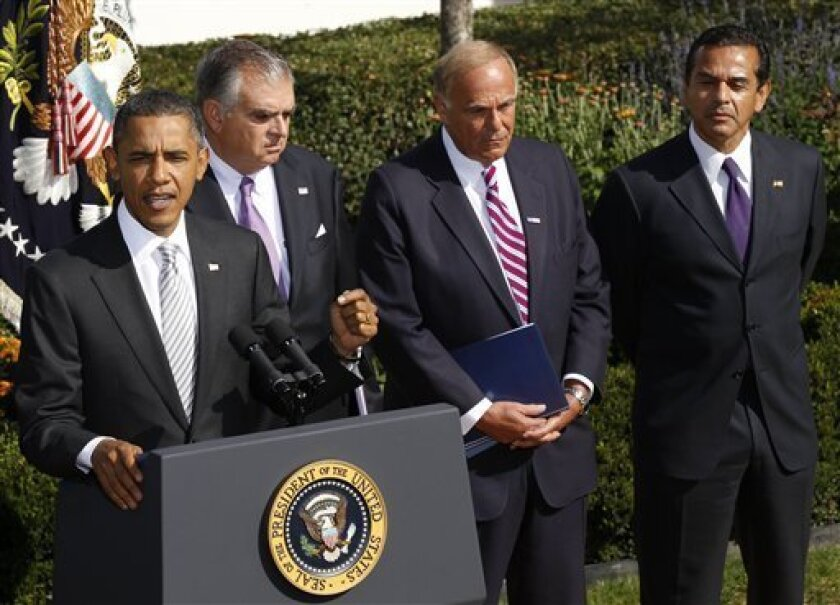President Barack Obama speaks to reporters in the Rose Garden to highlight a new report on the impact of his $50 billion infrastructure-investment proposal, Monday, Oct. 11, 2010 at the White House in Washington. On stage with Obama are from left to right, Secretary of Transportation Ray LaHood, Gov. Ed Rendell, D-Penn., and Los Angeles Mayor Antonio Villaraigosa. (AP Photo/Pablo Martinez Monsivais)