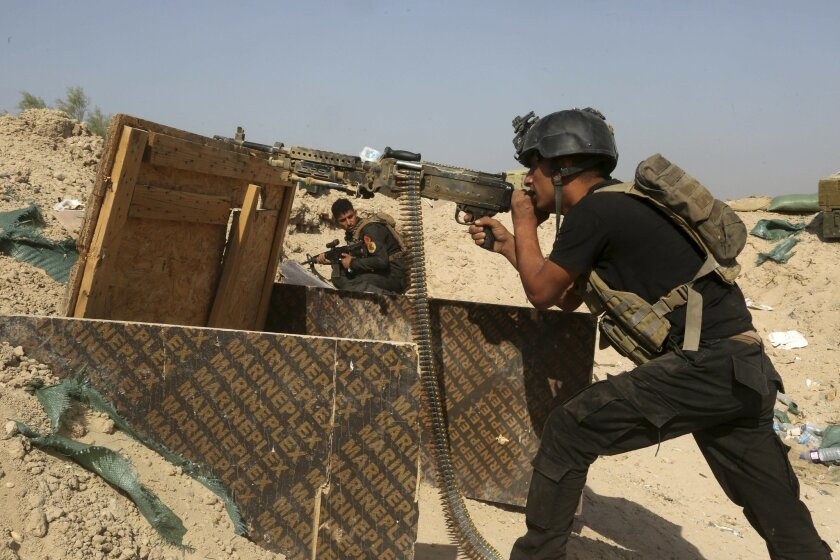 Iraqi counterterrorism forces face off with Islamic State militants in the Nuaimiya neighborhood of Fallujah, Iraq, Wednesday, June 1, 2016. Iraqi forces this week pushed into the city's southern sections after securing surrounding towns and villages more than 50,000 people are believed to be trapp