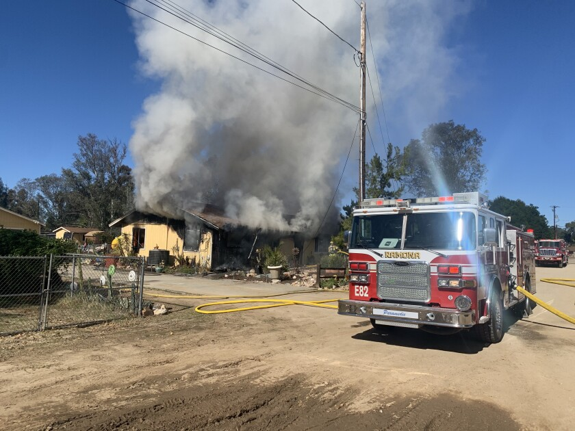 A fire at a home in Ramona on Thursday sent a woman to the hospital with smoke inhalation, a Cal Fire official said.