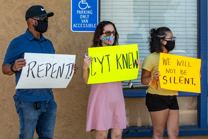 Odie, Tonia and Naomi Miller, joined the protest Friday outside of the Christian Youth Theater in El Cajon, Calif.
