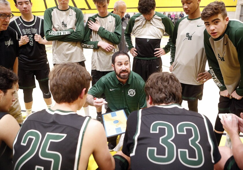 Sage Hill's head coach Billy Conlon gives his team final instructions late in the game against Yeshi