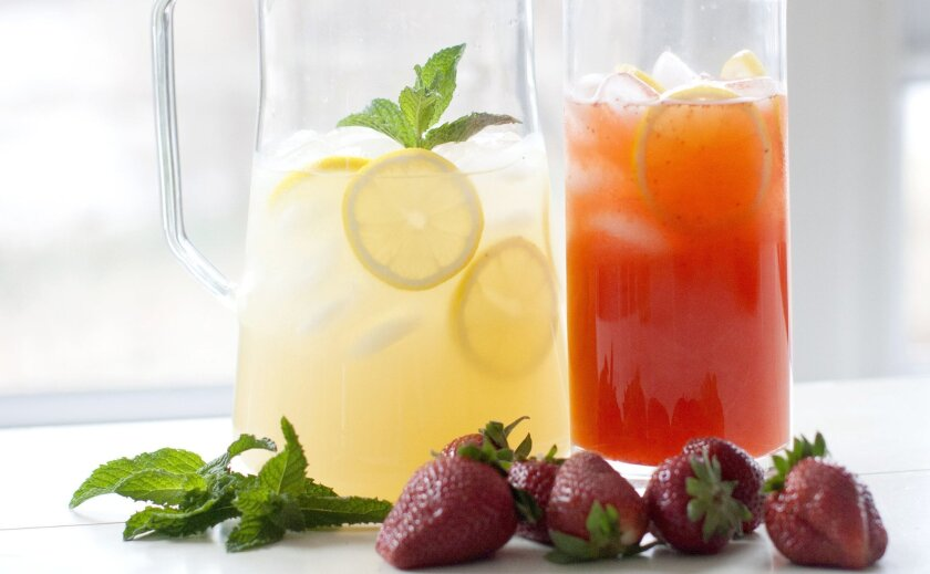 Rocking Chair Lemonade (left), accompanied by a pitcher of Strawberry Lemonade.