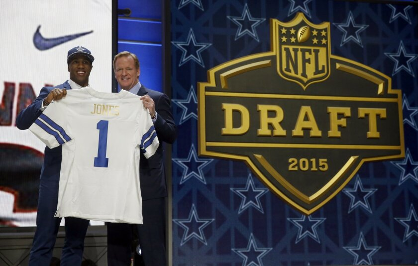 Connecticut defensive back Byron Jones poses for photos with NFL commissioner Roger Goodell after being selected by the Dallas Cowboys as the 27th pick in the first round of the 2015 NFL Draft,  Thursday, April 30, 2015, in Chicago. (AP Photo/Charles Rex Arbogast)