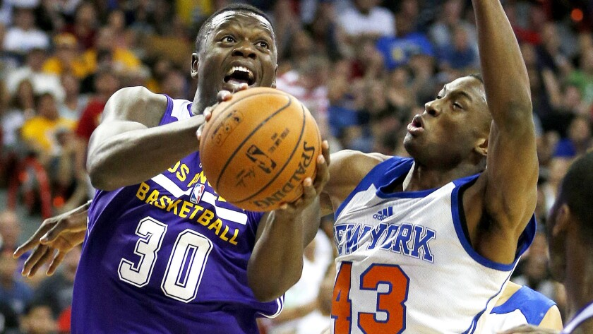 Lakers forward Julius Randle, driving past the Knicks' Thanasis Antetokounmpo during a game July 13 in Las Vegas, has used his size and quickness to average 11.7 points and 3.7 rebounds in 20 minutes or less a game in the summer league.