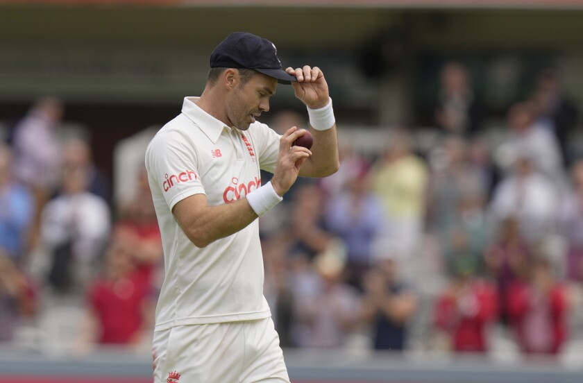 England's James Anderson celebrates after taking 5 wickets in the first innings during the second day of the 2nd cricket test between England and India at Lord's cricket ground in London, Friday, Aug. 13, 2021. (AP Photo/Alastair Grant)