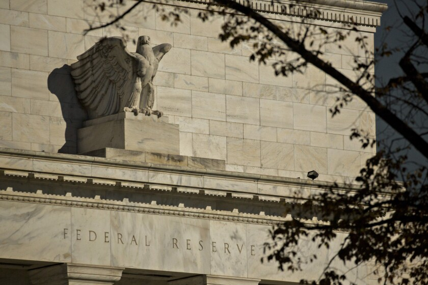 The Fed won't raise interest rates now, but hints more increases could be on the way.