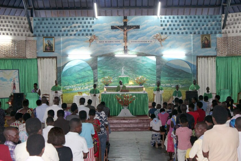 Burundians pray in a church in  Bujumbura, Burundi, for peace in the country, Sunday, Nov. 8, 2015. Witnesses say seven people have been killed in an overnight attack at a bar in the violence-prone Burundi capital, Bujumbura. Witnesses on Sunday said they heard gunshots Saturday night at a bar in t
