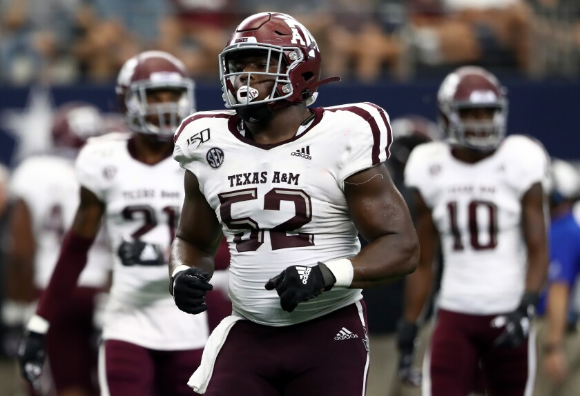 Justin Madubuike of Texas A&M prepares for the next play against Arkansas in September.