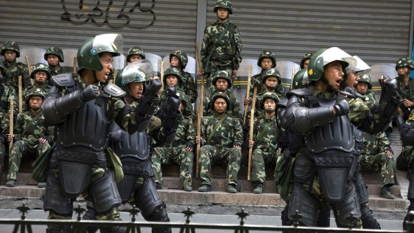 FILE - In this July 10, 2009, file photo, Chinese paramilitary police practice during a break from p