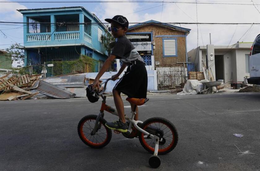 """El Departamento de la Familia de Puerto Rico y su secretaria, Glorimar Andújar, firmaron hoy un acuerdo de colaboración con la organización """"Save the Children"""" asegurar que las necesidades de los niños de la isla sean atendidas para que estos puedan continuar con sus rutinas diarias lo más pronto posible. EFE/Archivo"""
