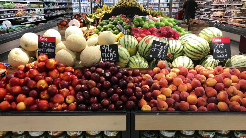 FILE- In this June 14, 2018, file photo, nectarines, plums, mangos and peaches are marked at a fruit