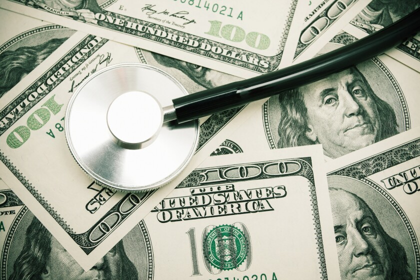 Stethoscope on US Paper Currency background