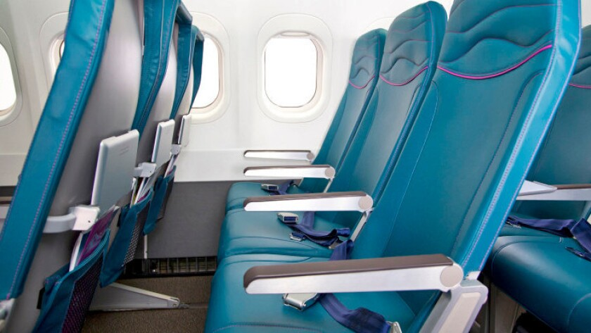 Ouch! The airline seat is hurting me. Here's what you can do to ease the pain.