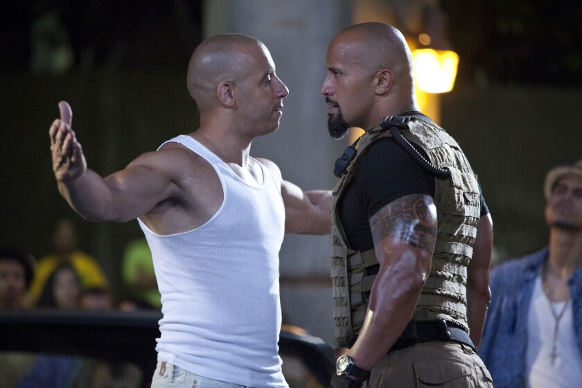 """The appeal of the """"Fast and Furious"""" franchise, which released its seventh installment in 2015, has long been based on both high-octane races and a much varied cast. Above, Vin Diesel, left, and Dwayne Johnson face off in """"Fast Five."""""""