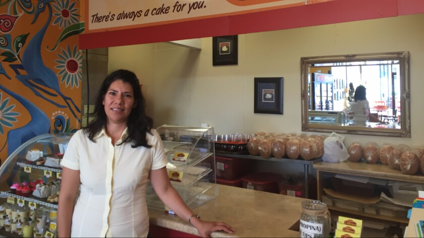 Zhenia Martinez, at her family's bakery in Charlotte, is voting for Clinton.