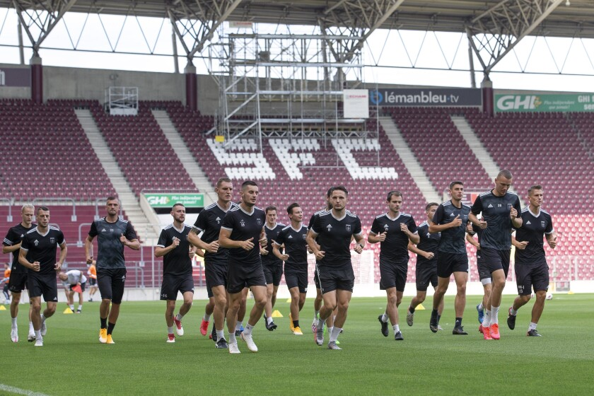 Slovakia's MFK Ruzomberok team warm up during a training session one day ahead of their UEFA Europa League first round qualifying soccer match against the Switzerland's team of Servette FC, at the Stade de Geneve stadium, in Geneva, Switzerland, Wednesday, Aug. 26, 2020. (Salvatore Di Nolfi/Keystone via AP)