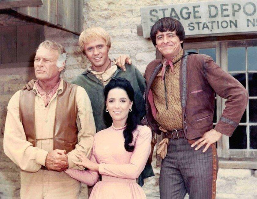 "Henry Darrow, right, with ""High Chaparral"" co-stars Leif Erickson, left, Mark Slade and Linda Cristal."