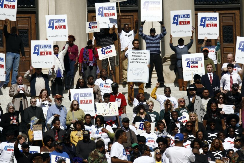 Several hundred people gather at the Mississippi State Capitol in Jackson for a rally to remove the Confederate battle emblem from the state flag, Thursday, Feb. 18, 2016, a month after flag supporters gathered there for their own event.  (AP Photo/Rogelio V. Solis)