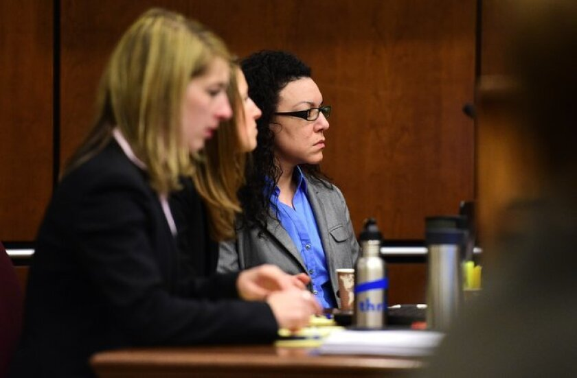 Dynel Lane, accused of cutting a stranger's unborn baby from her womb, appears in a Boulder District courtroom with her attorneys for her trial Wednesday, Feb. 17, 2016, in Boulder, Colo. Prosecutors charged Lane with attempted first-degree murder, assault and unlawful termination of a pregnancy in