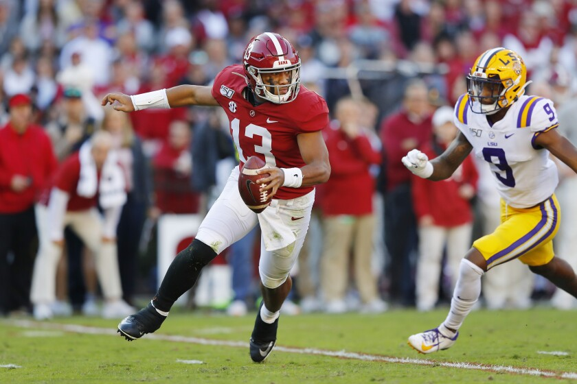 Alabama quarterback Tua Tagvailoa runs away from LSU defender Marcel Brooks in  November.
