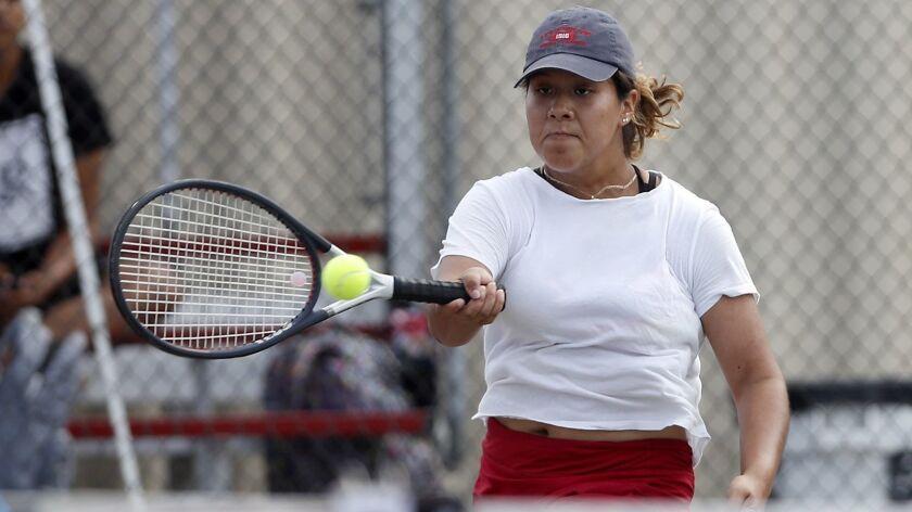Estancia High's Leslie Hernandez competes in a No. 2 singles set against Costa Mesa during an Orange