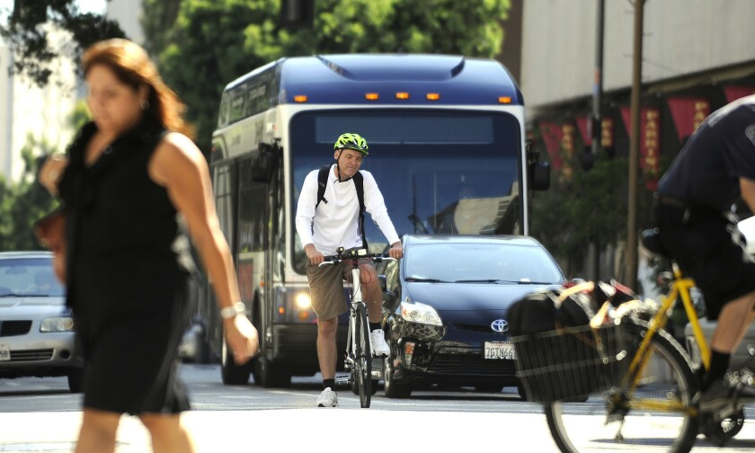 L.A.'s new 20-year transportation plan calls for hundreds of miles of new dedicated lanes for buses and bicyclists.