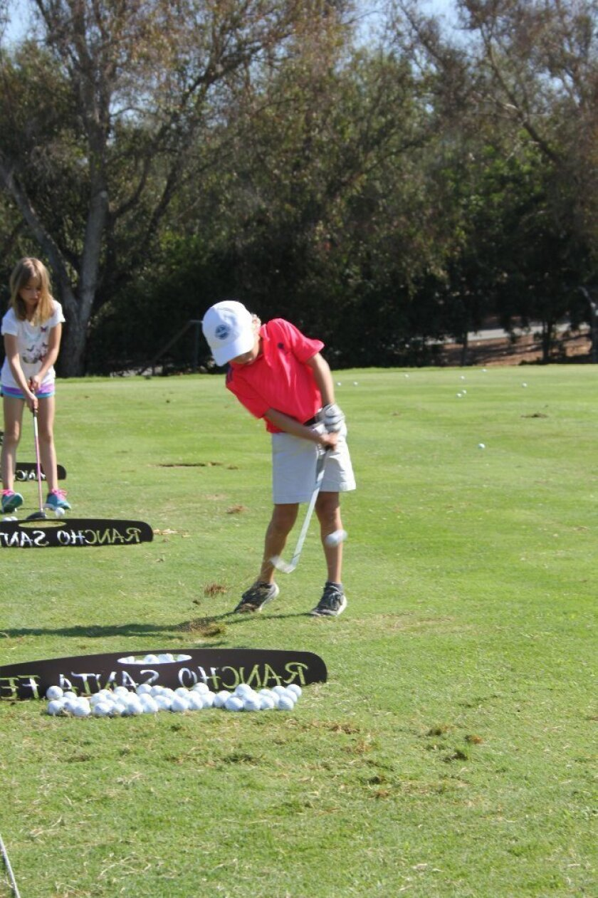 A young golfer on the course. Photo by Karen Billing