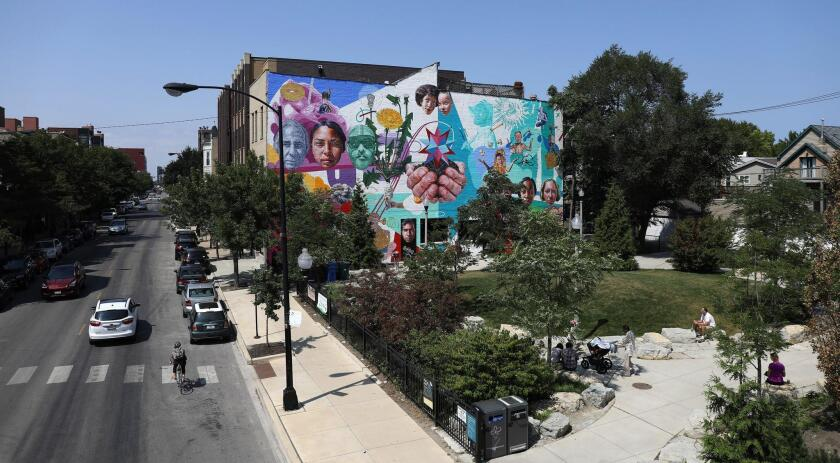 People enjoy a small park along Milwaukee Avenue off The 606 elevated path Aug. 25, 2017. A couple of aldermen are proposing that new developers set aside a number of affordable units in gentrifying areas along the Milwaukee Avenue corridor.