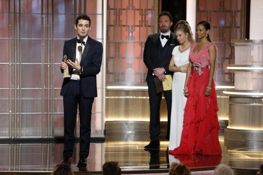 "Damien Chazelle accepts his director prize for ""La La Land"" at the 74th Golden Globe Awards on Sunday at the Beverly Hilton Hotel."