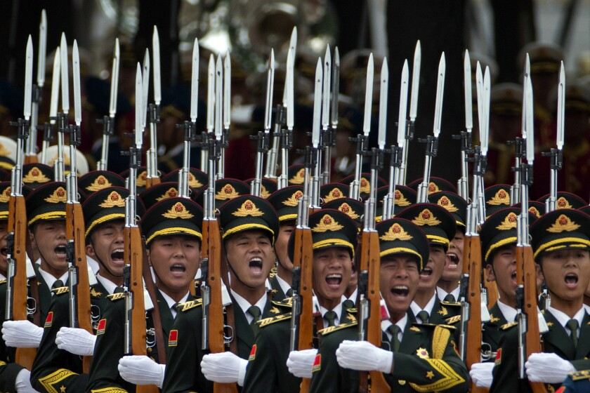 Members of a Chinese honor guard take part in a welcome ceremony for Belgium's King Philippe in Beijing on June 23. China's top legislature has adopted a sweeping new national security law touching on everything from the military and economy to religion and the Internet.