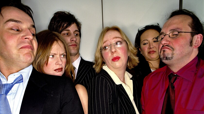 Group of business people in lift, close-up