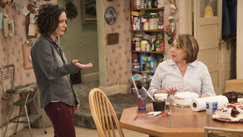 """This image released by ABC shows Sara Gilbert, left, and Roseanne Barr in a scene from """"Roseanne."""" G"""