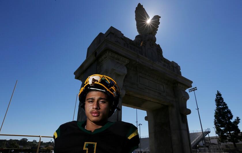Robert Sarmiento poses for a photo at San Pedro High.