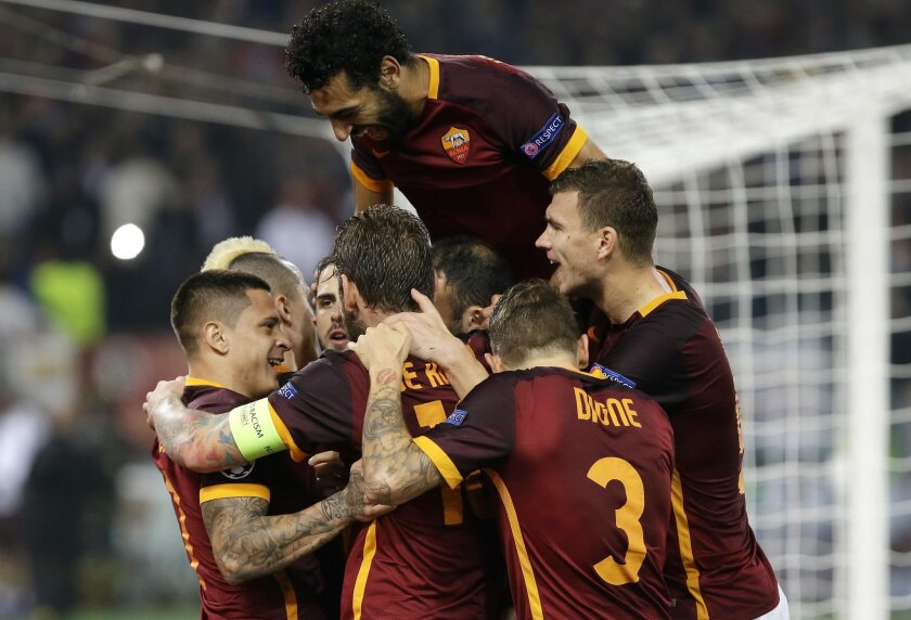 Roma's Miralem Pjanic, third from left, celebrates with his teammates after scoring during the Champions League group E soccer match between Roma and Bayer Leverkusen at the Olympic stadium, in Rome, Italy, Wednesday, Nov. 4, 2015. (AP Photo/Gregorio Borgia)