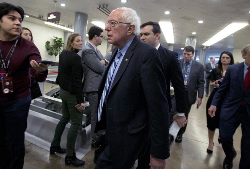 Sen. Bernie Sanders of Vermont walks to the Senate chamber Wednesday for the impeachment trial of President Trump.