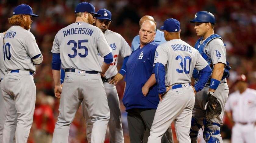 Dodgers pitcher Brett Anderson is pulled from a game against the Reds in the fourth inning on Aug. 20.