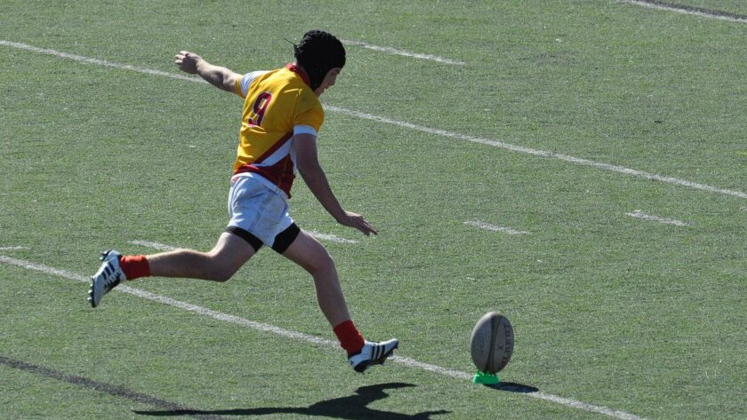 Cathedral Catholic student Ronan Nelson kicks a conversion for his club rugby team before his injury.
