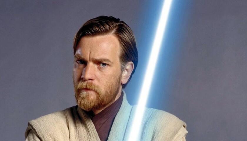 a man holding a lightsaber