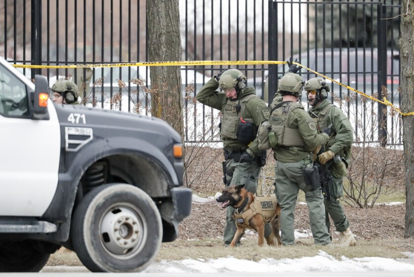 Police outside the Molson Coors Brewing Co. campus in Milwaukee on Feb. 26.