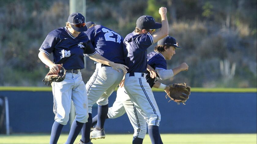 San Marcos infielders celebrate their win against Rancho Bernardo in the Lions Tournament high schoo